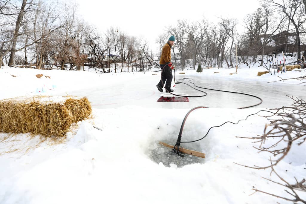 RUTH BONNEVILLE / WINNIPEG FREE PRESS  Reder draws water from the Seine River to flood the homemade rink