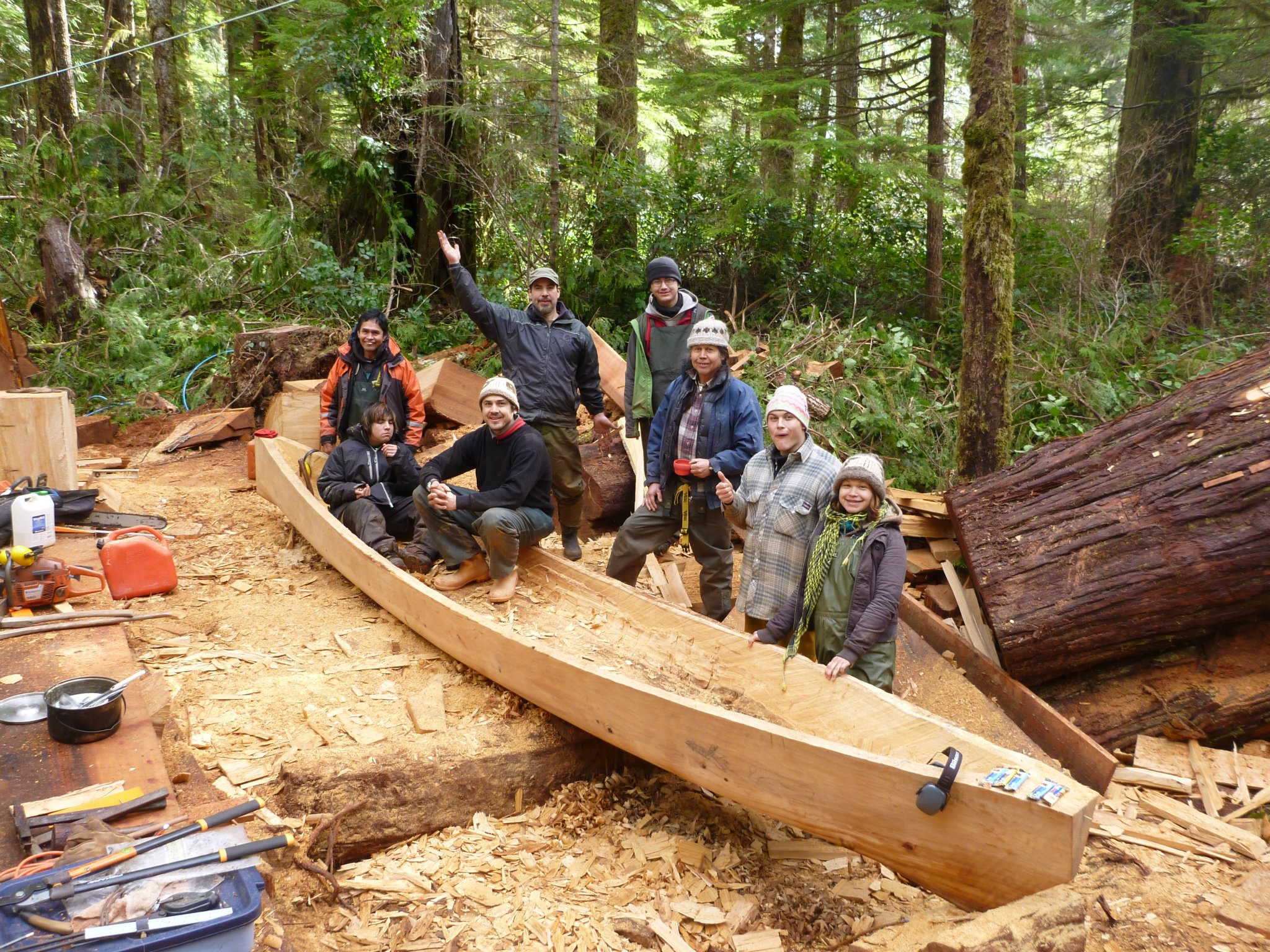 Photo: Joe Martin and assistants carving canoe ( Layla Čuucqa Rorick).