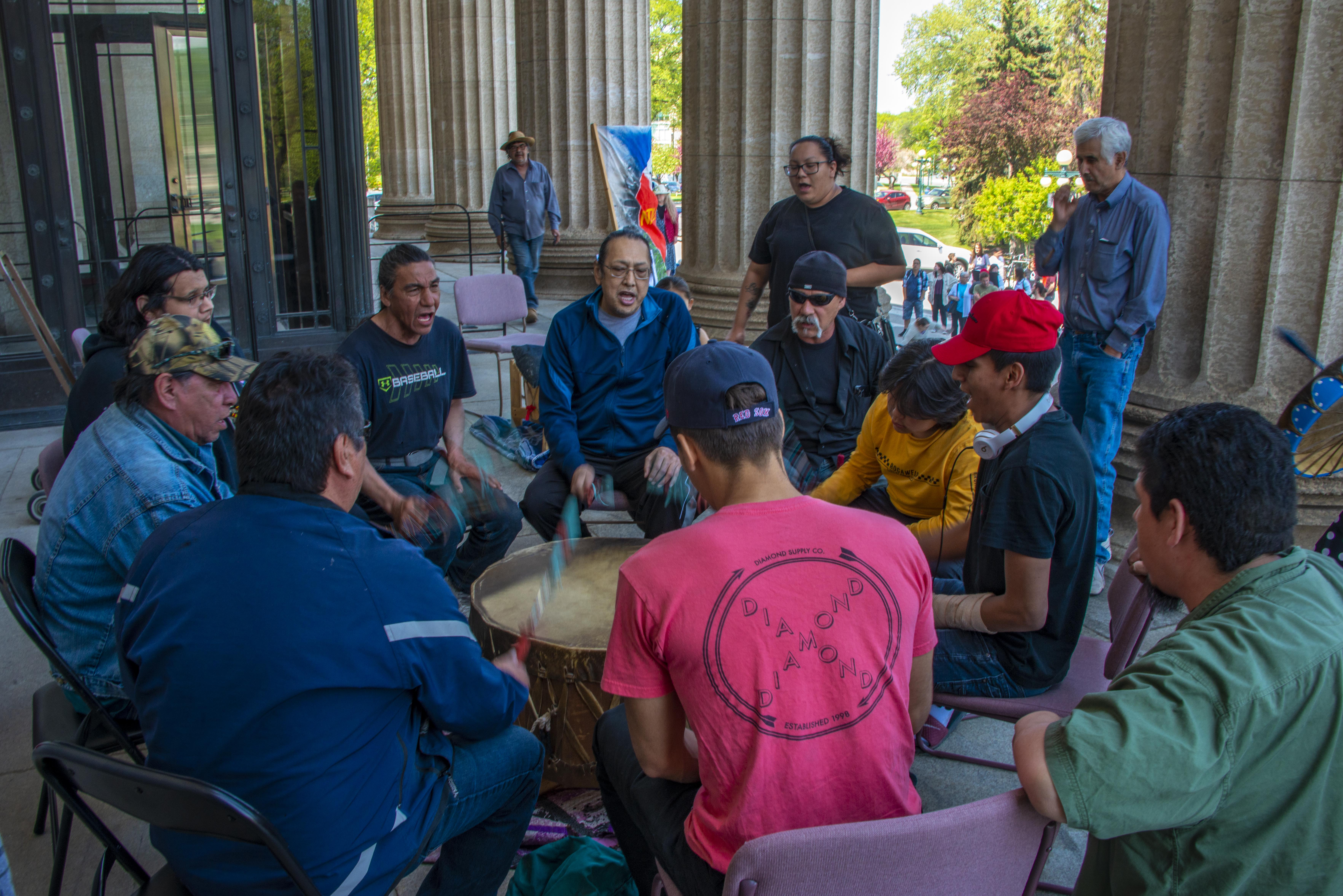 A drum group at the Manitoba Legislature protesting the the mine