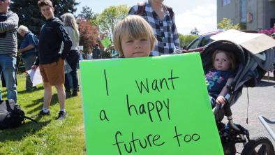 Four-year-old Jonah Arbez holds a protest sign at Friday's Strike for Climate on the steps of Nanaimo City Hall. (COLE SCHISLER/Black Press)