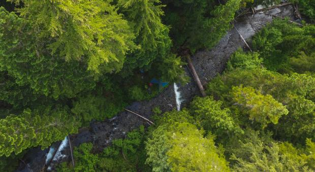An aerial photo of 26 Mile Creek in the Donut Hole with a backpackers tent